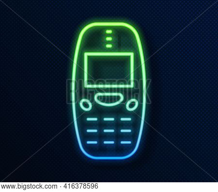 Glowing Neon Line Old Vintage Keypad Mobile Phone Icon Isolated On Blue Background. Retro Cellphone