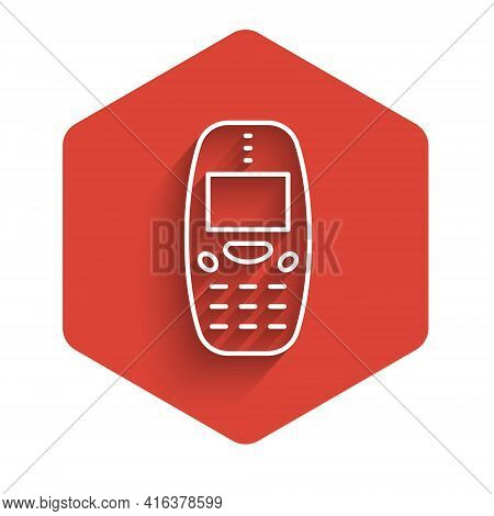 White Line Old Vintage Keypad Mobile Phone Icon Isolated With Long Shadow. Retro Cellphone Device. V