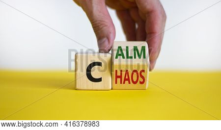 Stop Chaos, Time To Calm. Male Hand Turns A Wooden Cube And Changes The Word 'chaos' To 'calm'. Beau