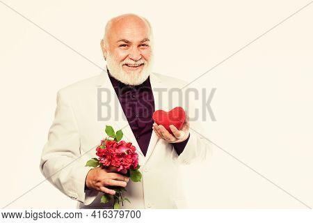 Man Hold Heart Symbol Of Love. Dating Services For Elderly People. Gentleman Concept. True Gentleman