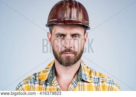Man Architect With Serious Look. Guy Wear Worker Uniform. Handsome Builder In Helmet. Mature Man Wea
