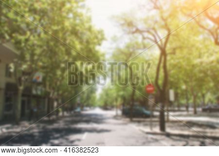 Blurred Photography Defocus Green Summer Street In Europe