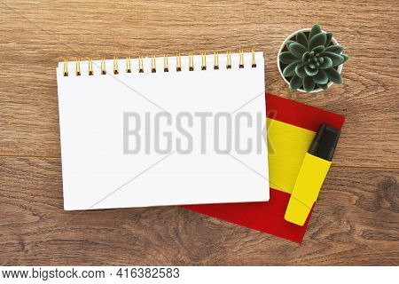 Notebook Empty With Place For Text On Spanish, Pen, Spain Flag, Marker On Wooden Brown Desktop