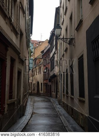 Charming Narrow Empty Alley Lane Road Street With Old Traditional Houses Buildings In Strasbourg Gra