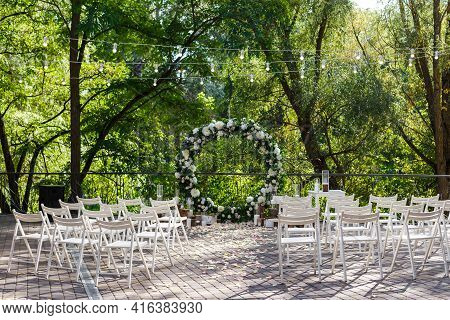Nature Theme In Wedding Ceremony Decoration. Newlyweds Arch Decorated In Rustic Style