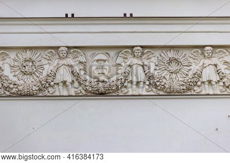 Bas-relief With Images Of Angels On Facade Of Trinity Cathedral In St. Petersburg, Russia