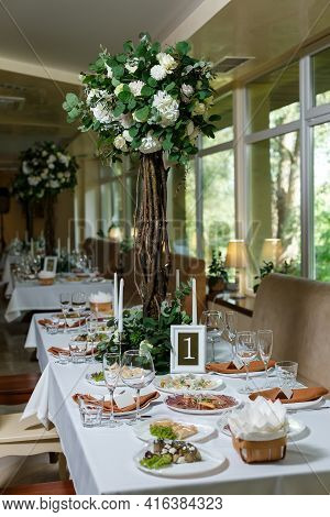 Newlyweds Table Setting Decorated In Rustic Style. Nature Theme In Decoration