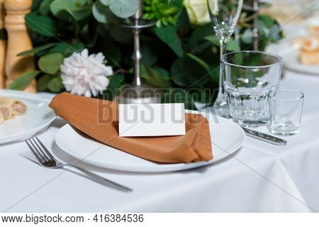 Wedding Table Setting With Blank Guest Card, Napkin And Dish On A Wooden Plate. Rustic Decor