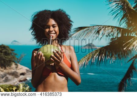 Portrait Of A Happy Smiling Young Svelte African-american Woman With Curly Afro Hair, In A Swimsuit,