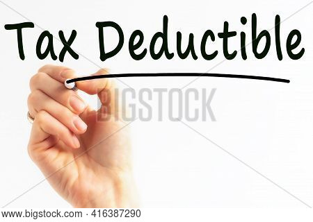 Hand Writing Inscription Tax Deductible With Black Color Marker, Concept, Stock Image