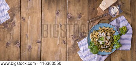 Cime Di Rapa Pasta In A Plate On With Parmesan On A Wooden Table. Traditional Food Of The South Of I