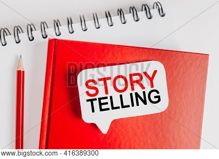 Text Storytelling Is The Best Marketing On A White Sticker With Office Stationery Background. Flat L