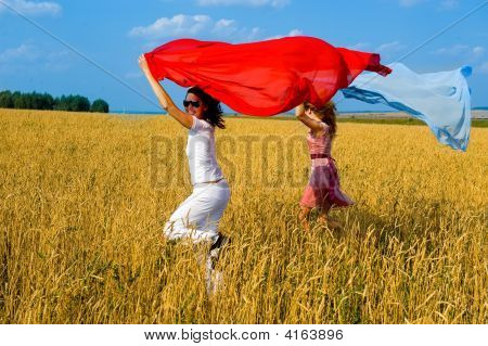 Two Young Beautiful Woman Running On The Fild