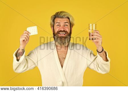 Wow. Healthcare Of Man Taking Medicine At Home. Handsome Man With Pill And Glass Of Water. Take Pain