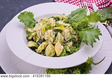 Cime Di Rapa Pasta In A Plate On With Parmesan On Table. Traditional Food Of The South Of Italy, Fro