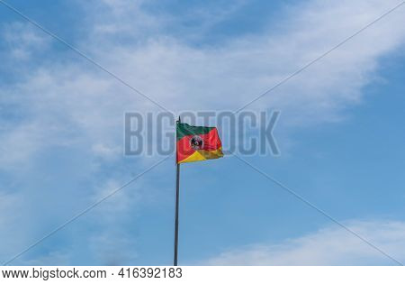 Flag Of The State Of Rio Grande Do Sul - Brazil On Blue Natural Background. Official Symbols Of The