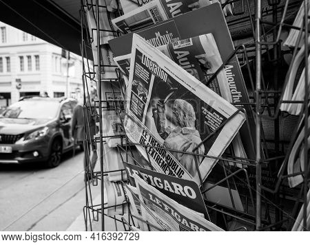 Paris, France - April 11, 2021: Press Kiosk International Press With Liberation Newspaper Front Page