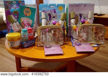 Yeppoon, Queensland, Australia - April 2021: Gifts And Chocolate Eggs On A Table Ready For Children