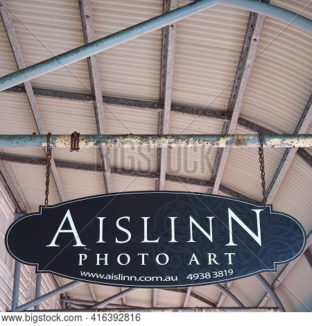 Yeppoon, Queensland, Australia - April 2021: Sign Hanging By A Chain From Roof Rafters Advertising A