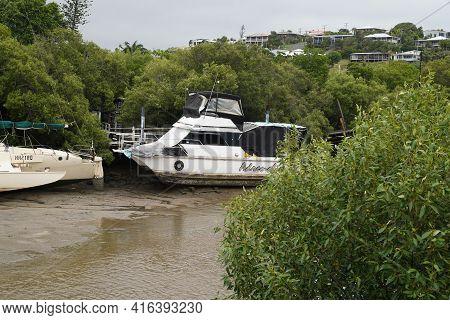 Yeppoon, Queensland, Australia - April 2021: Catamarans Moored In A Coastal Creek At Low Tide