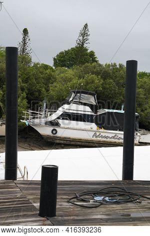 Yeppoon, Queensland, Australia - April 2021: Catamaran Moored In A Coastal Creek At Low Tide