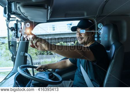 Asian Truck Drivers Locate Their Position On  Digital Map, Realistically Displayed On Touch Screen.