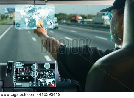 Asian Truck Driver Searching For Location On Digital Map Realistically Displayed Screen And Communic
