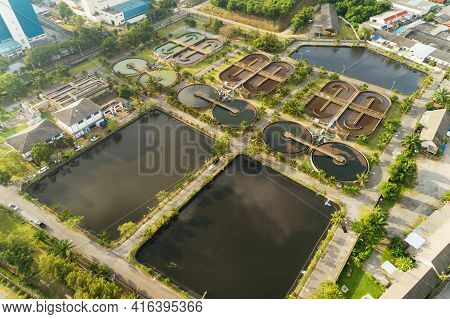 Aerial View High Angle View Top Down Drone Shot Of The Sewage Treatment Plant.the Solid Contact Clar