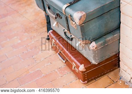 Turquoise And Brown Vintage Old Classic Travel Leather Suitcases With Handle And Metallic Protection
