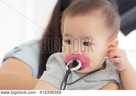 Closeup Portrait Of Asian Newborn, Happiness Face Little Baby Girl With Innocent, Eyes Of Infant Wit