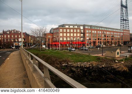 NORWALK, CT,USA  - APRIL 10, 2021:  Downtown morning view from bridge at  Washington Street with Water street architecture