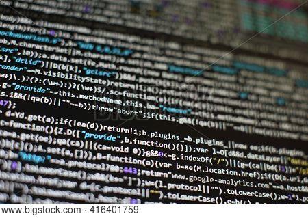 Website Html Code On The Laptop Display Closeup Photo. Information Technology Website Coding Standar