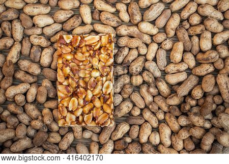 Peanut Chikki Indian Brittle Sweet Isolated On Peanut Pods With Copy Space, Peanut Jaggery Sweet Sna