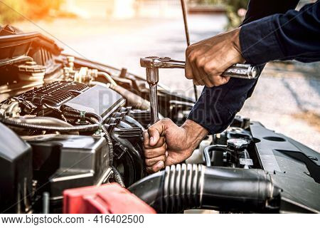 Car Maintenance, Close-up Hands Of Auto Mechanic Are Using The Wrench To Repairing Car Engine Is Pro