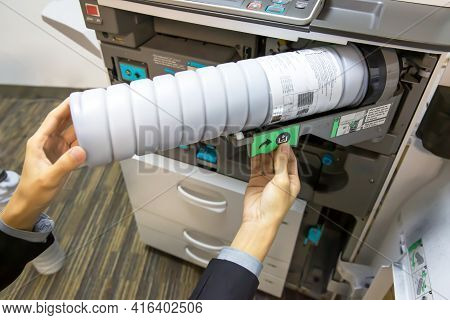 Close Up Hand Of Technician To Open Cover Of The Photocopier Machine To Fix The Problem And Replacin