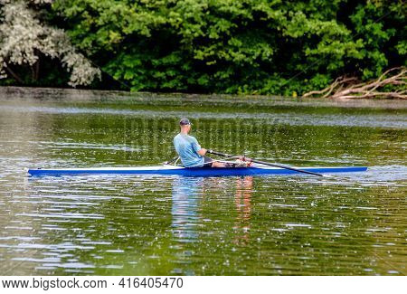 Man Floating In A Canoe On The River