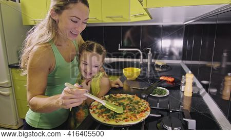 Mother Teaching Daughter Smart Girl Learning To Cook. Mistress Children To Cook A Neapolitan Egg Fri