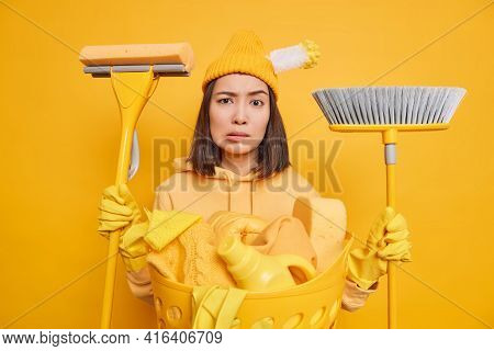 Serious Puzzled Housewife Doesnt Know From What To Begin Cleaning Dressed In Casual Clothes Uses Mop