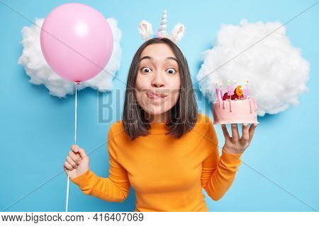 Cute Asian Birthday Girl Looks With Temptation At Camera Licks Lips Wants To Eat Delicious Cake Has