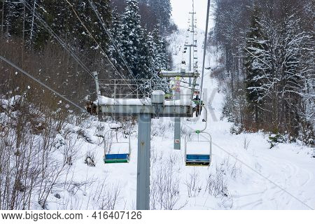 Funiculars Are Located Among Hilly Mountains And Trees Covered By Snow In Winter Frosty Times. Conce