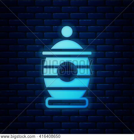 Glowing Neon Funeral Urn Icon Isolated On Brick Wall Background. Cremation And Burial Containers, Co