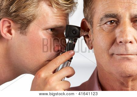 Doctor Examining Male Patient's Ears poster