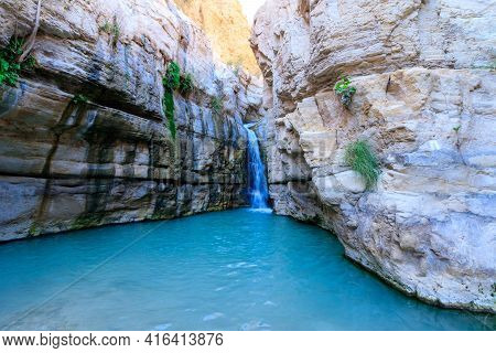 Flowing Water To A Large Pool Of Clear Water, In The Hidden Waterfall In Nahal Arugot, Ein Gedi Isra
