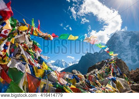 Colorful Prayer Flags On Thokla Pass, Everest Base Camp Trek In Himalayas, Nepal. Khumbu Valley, Eve