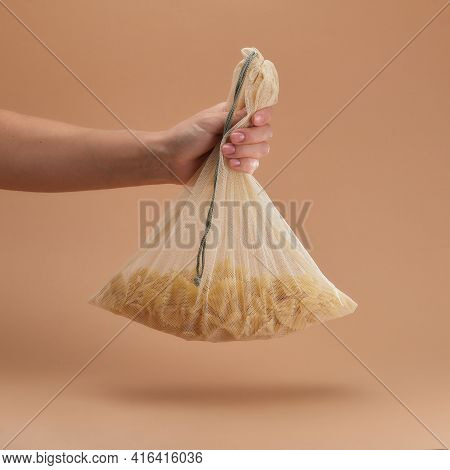 Human Holds In Hand A Reusable Fabric Eco Bag With Pasta. Reusable Eco-friendly Products. Zero Waste