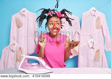 Glad Busy Housewife With Combed Braids Dirty Dace After Eating Sweet Homemade Pie Points Above Stand