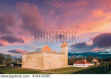 Kuressaare, Saaremaa Island, Estonia. Episcopal Castle In Sunset. Traditional Medieval Architecture,