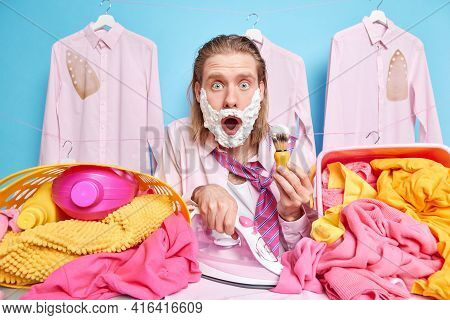 Shocked Busy Househusband Does Different Tasks At One Time Irons Laundry Shaves Being Late For Work