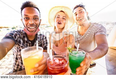 Multiracial People Trio Taking Selfie With Open Face Masks At Beach Bar - New Normal Life Style Conc