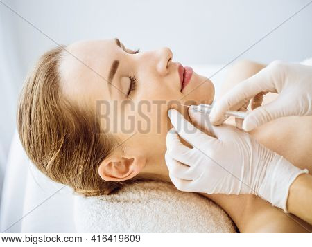 Beautiful Woman Receiving Beauty Injections With Closed Eyes In Medical Center. Beautician Doctor Ha